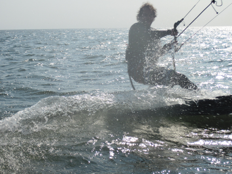 Nick is kiting around the boat in the Outer Banks Sound